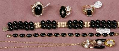 1399T GROUPING OF 14K GOLD AND ONYX JEWELRY Comprisin