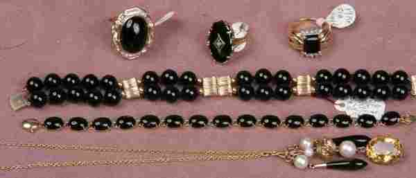 GROUPING OF 14K GOLD AND ONYX JEWELRY| Comprisin
