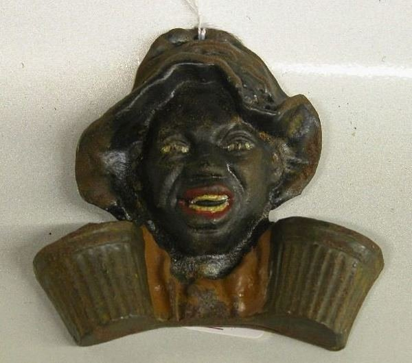 4006: FIGURAL CAST IRON MATCHHOLDER| Depicting boy with