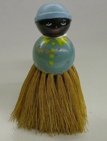 4015: FIGURAL WOODEN CLOTHES BRUSH| Depicting mammy, wi