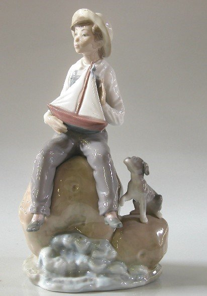 19: LLADRO PORCELAIN FIGURE| ''Boy with Boat'', #5166,