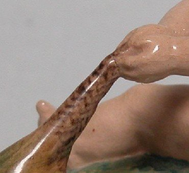 46: DULWICH POTTERY FIGURE| Depicting Putti holding ont - 5
