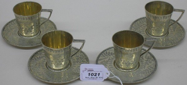 1021: ***FOUR ENGLISH STERLING SILVER CUPS AND SAUCERS