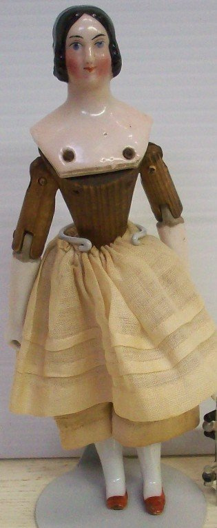 135: EARLY PORCELAIN AND WOOD DOLL