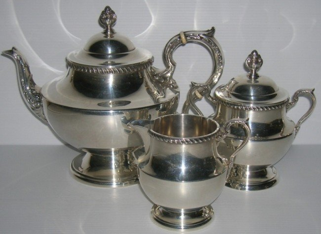 1002: ***POOLE THREE PIECE STERLING SILVER TEA SERVICE