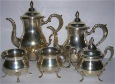 1003: ***LUNT FIVE PIECE STERLING SILVER COFFEE AND TEA