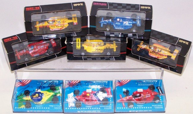 1011: ***GROUP OF EIGHT SIGNED 1/43 DIE CAST INDY CARS