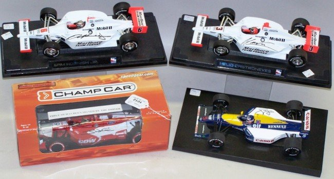 1012: ***GROUP OF FOUR SIGNED 1/18 DIE CAST