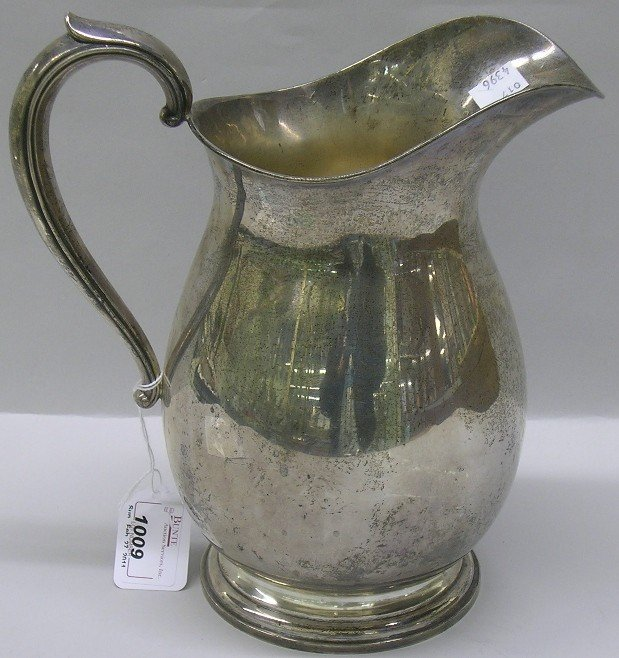 1009: ***M.F.H. CO. STERLING SILVER WATER PITCHER