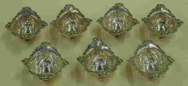 SET OF SEVEN STERLING SILVER FOOTED NUT