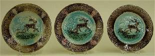 SET OF THREE MAJOLICA PLATES Stag and