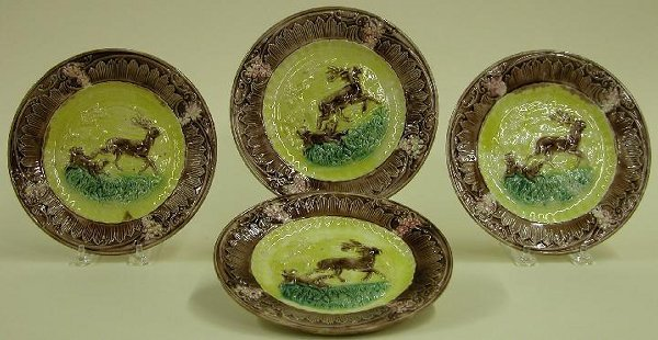 1016: FOUR MAJOLICA PLATES  Stag and hound pa
