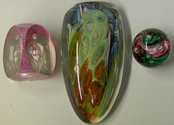 3018: THREE ART GLASS PAPERWEIGHTS One marked Schuster