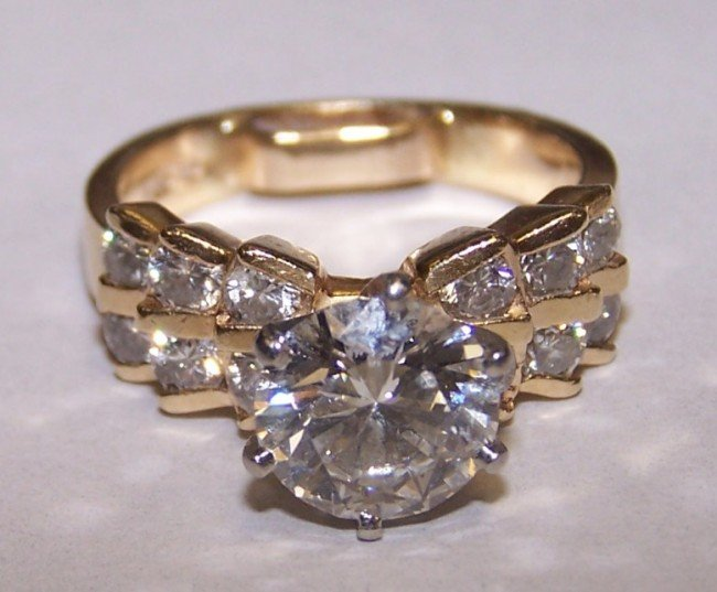 1534: ***LADY'S 14K YELLOW GOLD AND DIAMOND RING