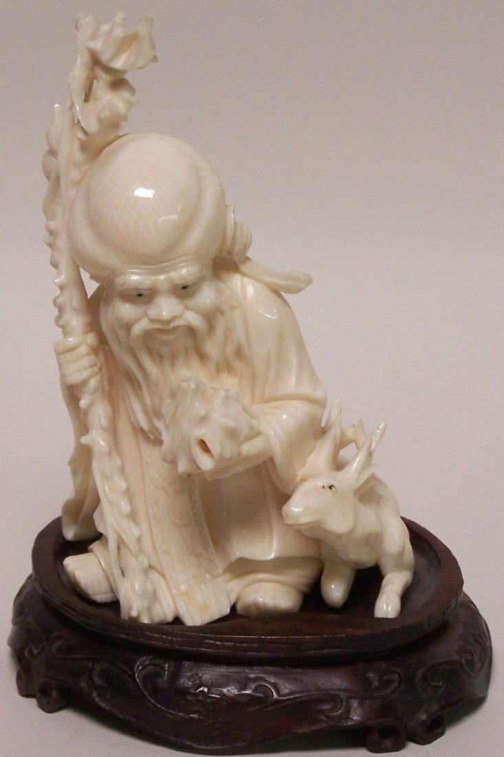 1010: ***CHINESE CARVED IVORY FIGURE