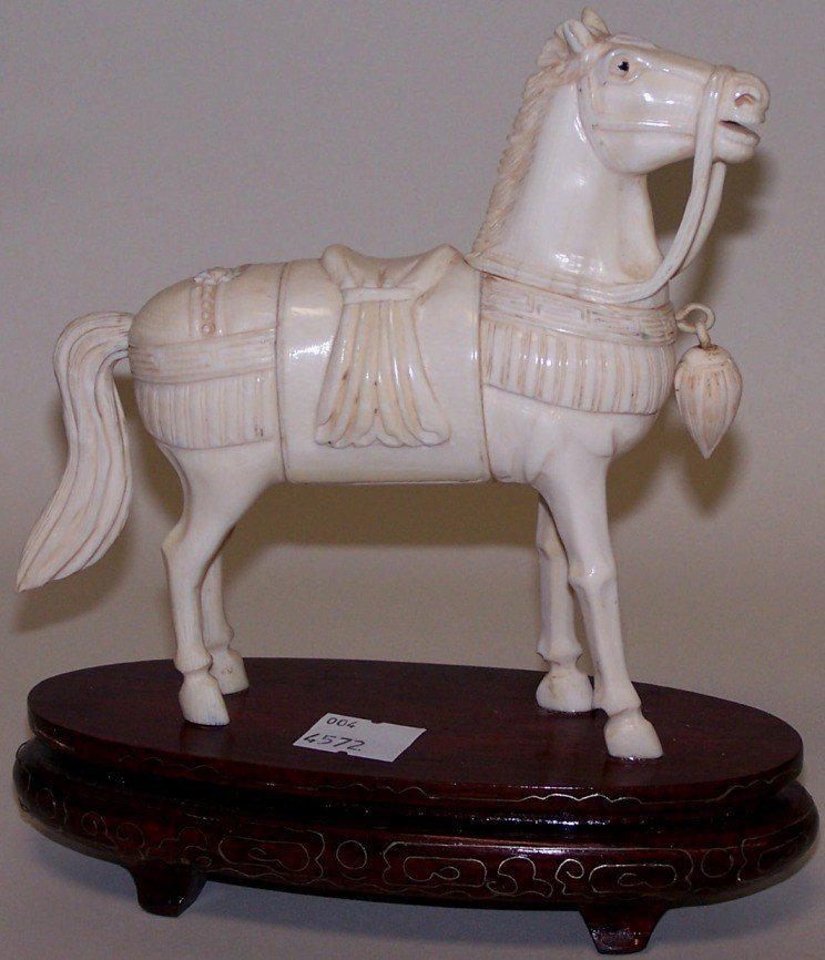 1018: ***CHINESE CARVED IVORY HORSE