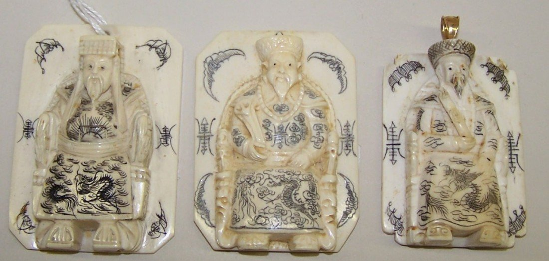 1021: ***THREE CHINESE CARVED IVORY PENDANTS