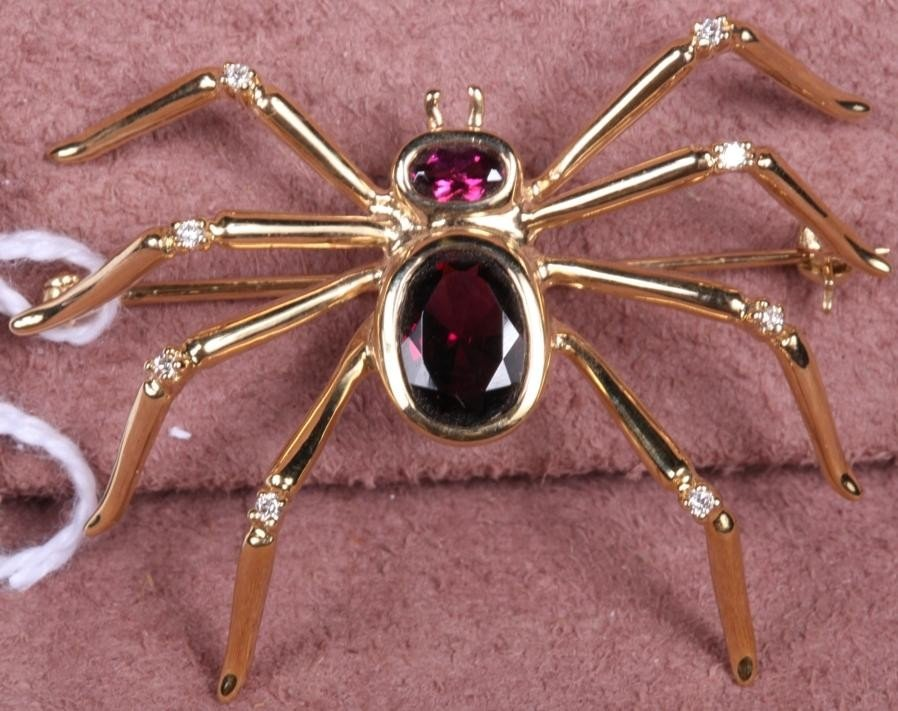 1209: 14K YELLOW GOLD AND GARNET INSECT BROOCH