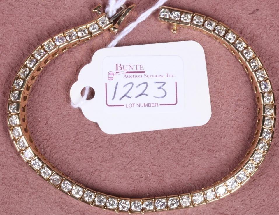 1223: 14K YELLOW GOLD AND DIAMOND LINE BRACELET