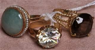 1319: THREE LADY'S 14K YELLOW GOLD RINGS