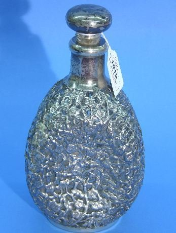1019: STERLING SILVER OVERLAY DECANTER| Having three pi