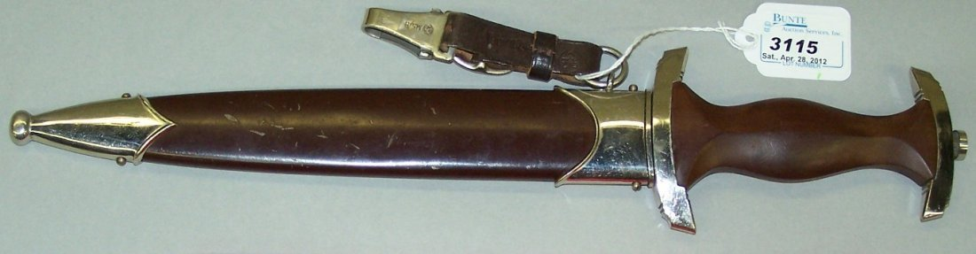 3115: ***GERMAN S.A. DAGGER WITH SHEATH AND BELT HANGER