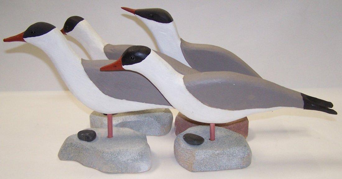 3246: ***ANDERLIK, JOE| (1922-2011) Four carved wood bi