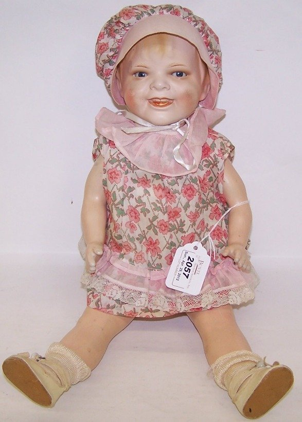 2057: ***GERMAN CERAMIC HEAD CHARACTER DOLL