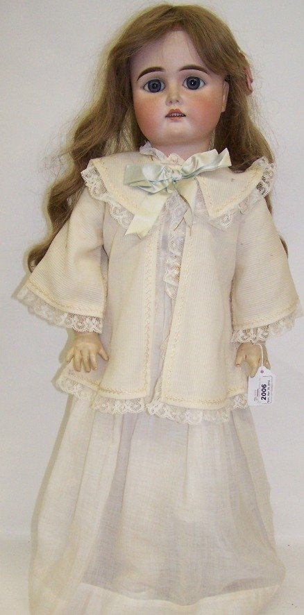 2006: ***BISQUE HEAD DOLL| Having fixed eyes