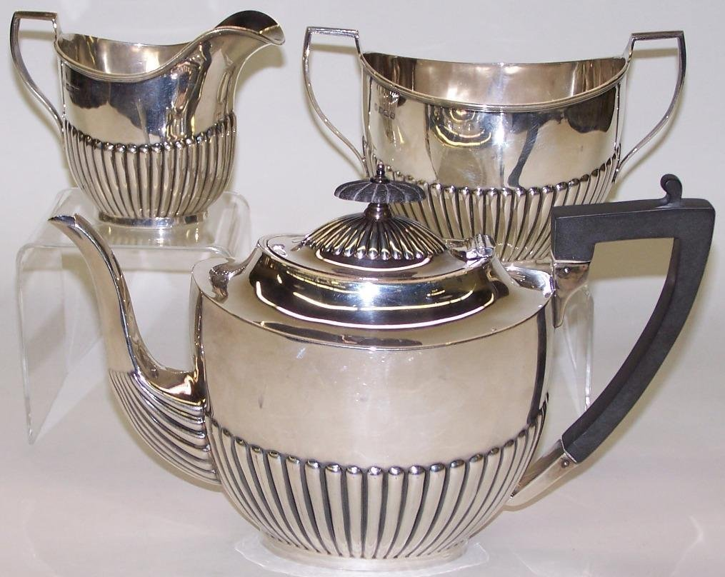 1023: ***ENGLISH STERLING SILVER TEA SERVICE