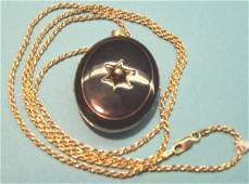 1404: VICTORIAN YELLOW GOLD AND BLACK ENAMEL