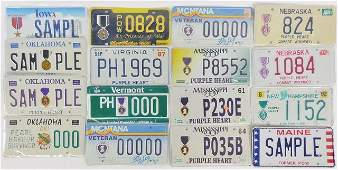 GROUP OF MILITARY COMMEMORATIVE LICENSE PLATES