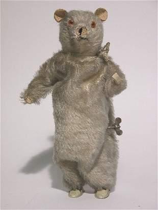 WIND-UP TEDDY BEAR - CIRCA 1940'S| Beige mohair, gla