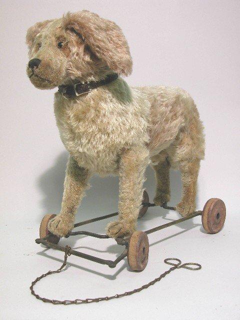 11: STEIFF DOG ON WHEELS| Beige mohair, glass eyes, str