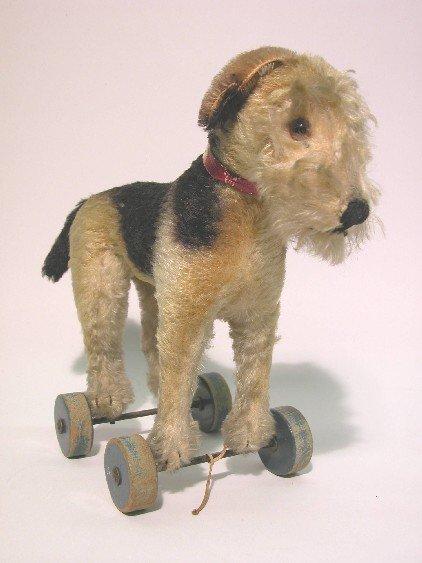 12: STEIFF DOG ON WHEELS| Brown and black mohair, terri