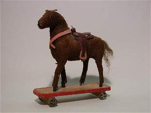 PULL-TOY HORSE| Brown mohair, on platform wheels, g