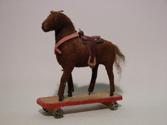 13: PULL-TOY HORSE| Brown mohair, on platform wheels, g