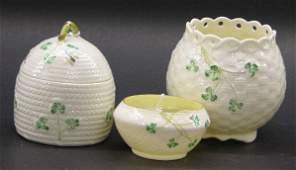 215: ***THREE PIECES OF BELLEEK PORCELAIN| Vase with gr