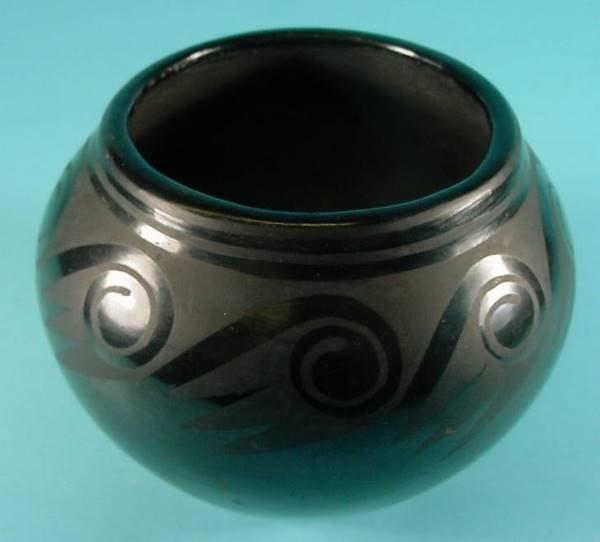 2009: ANNA| San Ildefonso black on black pottery jar wi