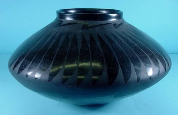 2012: CASAS GRANDE| Black on black pottery jar with fea