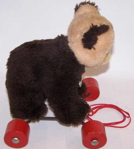 *STEIFF BEAR ON WHEELS - 4