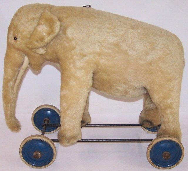 *EARLY TOY ELEPHANT ON WHEELS