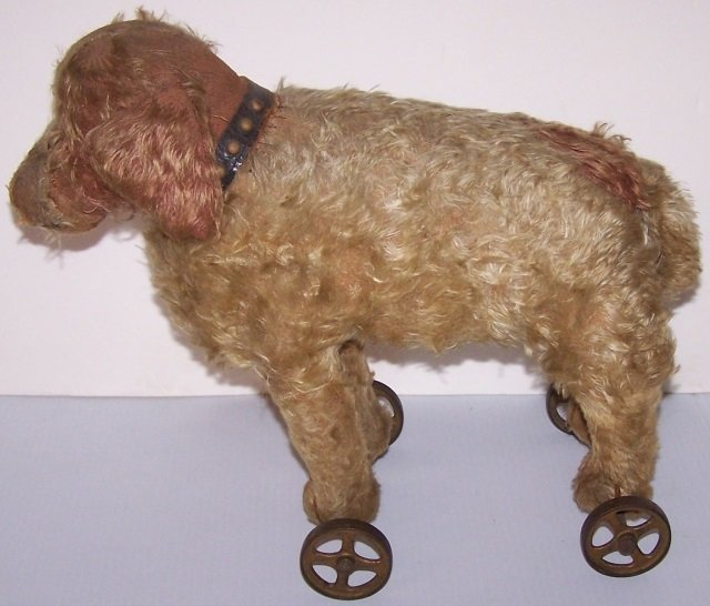 *EARLY STUFFED TOY DOG ON WHEELS