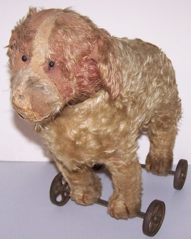*EARLY STUFFED TOY DOG ON WHEELS - 2