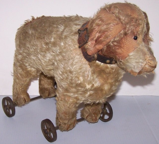 *EARLY STUFFED TOY DOG ON WHEELS - 3