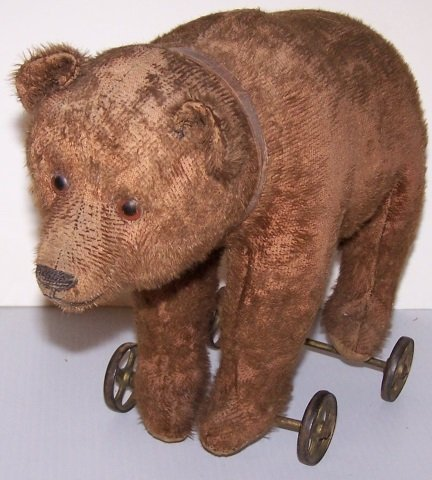 *EARLY STUFFED TOY BEAR ON WHEELS