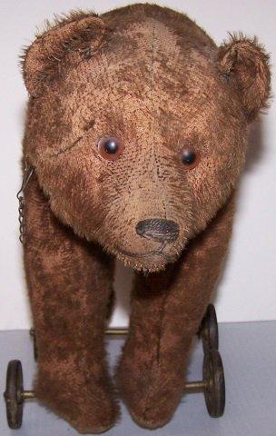 *EARLY STUFFED TOY BEAR ON WHEELS - 5