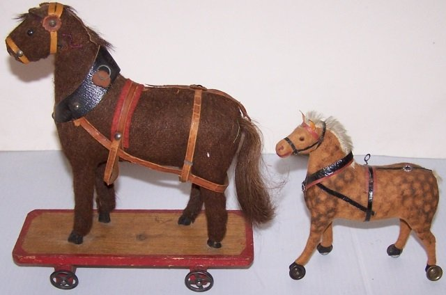 *2 EARLY TOY HORSES ON WHEELS