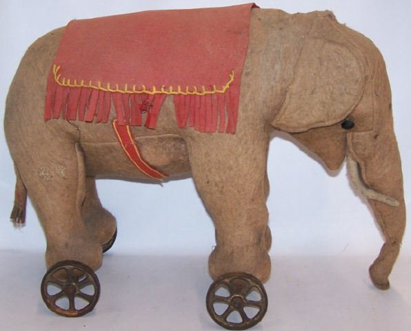 *EARLY STUFFED ELEPHANT ON WHEELS