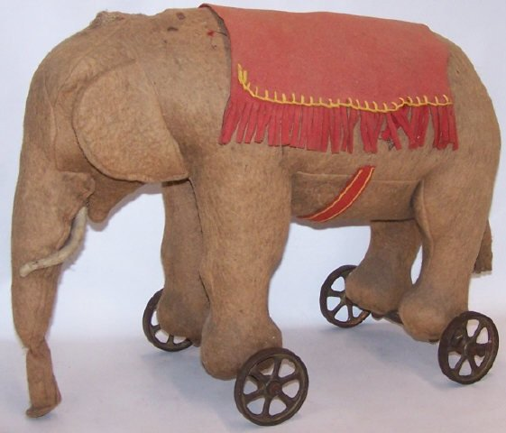 *EARLY STUFFED ELEPHANT ON WHEELS - 5
